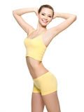 Happy young woman with beautiful slim body Royalty Free Stock Image