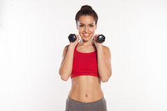 Happy young woman working out with dumbbells Royalty Free Stock Photo