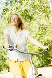 Happy young woman on the bicycle Royalty Free Stock Photography
