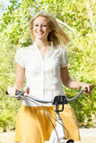 Happy young woman on the bicycle Royalty Free Stock Photo