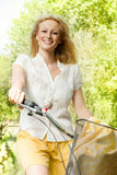 Happy young woman on the bicycle Stock Photos