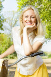 Happy young woman on the bicycle Stock Photo
