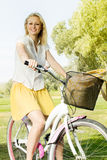 Happy young woman on the bicycle Royalty Free Stock Image