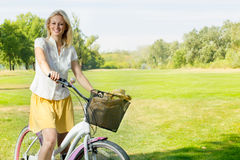 Happy young woman on the bicycle Stock Images