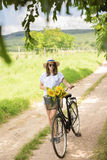 Happy young woman with bicycle Stock Photography