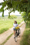 Happy young woman with bicycle Stock Photo