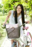 Happy young woman with bicycle Royalty Free Stock Image