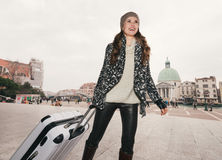 Happy young woman with big luggage bag at train station, Venice Stock Photos