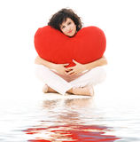 Happy young woman with big red heart Royalty Free Stock Photos