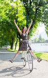 Happy young woman on bike Royalty Free Stock Images