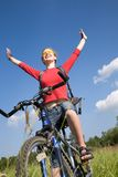 Happy young woman on bike Royalty Free Stock Photo