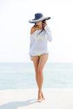 Happy young woman in bikini and beach hat Stock Photos