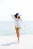 Happy young woman in bikini and beach hat Royalty Free Stock Photography