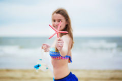Happy young woman in bikini with snorkelling equipment and pink starfish Stock Images