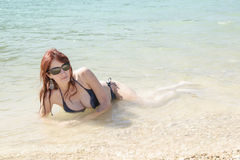Happy young woman in bikini with sunglasses Royalty Free Stock Image