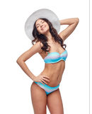 Happy young woman in bikini swimsuit and sun hat Stock Photos