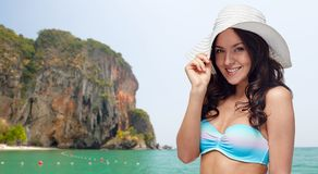Happy young woman in bikini swimsuit and sun hat Royalty Free Stock Images