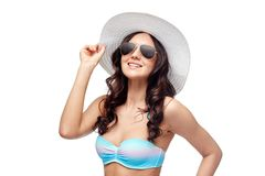 Happy young woman in bikini swimsuit and sun hat Stock Image