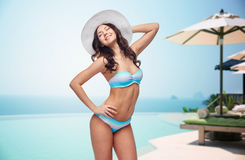 Happy young woman in bikini swimsuit and sun hat Royalty Free Stock Photos