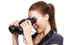 Happy young woman with binoculars Royalty Free Stock Image