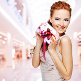Happy young woman with birthday present in hands stock images