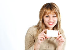 Happy young woman with blank card Stock Images