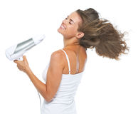 Happy young woman blow-dry Stock Images