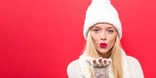 Happy young woman blowing a kiss Royalty Free Stock Image