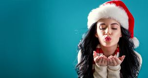 Happy young woman blowing a kiss Stock Photography