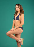 Happy young woman in blue bikini swimsuit posing Royalty Free Stock Photography