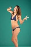 Happy young woman in blue bikini swimsuit posing Royalty Free Stock Photo