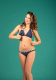 Happy young woman in blue bikini swimsuit posing Royalty Free Stock Images
