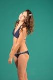 Happy young woman in blue bikini swimsuit posing Stock Image