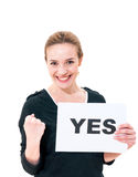 Happy young woman with board yes Stock Photo