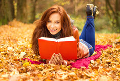Happy young woman with book Stock Photos