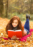 Happy young woman with book Royalty Free Stock Images