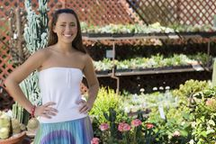 Happy Young Woman At Botanical Garden Royalty Free Stock Photo