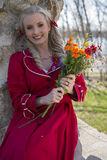 Happy young woman with bouquet of flowers Stock Image