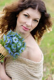 Happy young woman with a bouquet Royalty Free Stock Image
