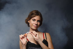 Happy young woman with the broken cigarette. Royalty Free Stock Photo