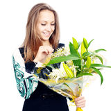 Happy young woman with a bunch of flowers Royalty Free Stock Photo
