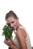 Happy young woman with with a bundle of fresh mint Stock Image