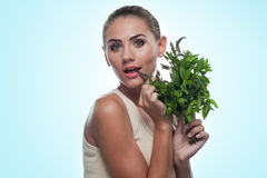 Happy young woman with a bundle of fresh mint. Concept vegetaria Stock Image