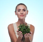 Happy young woman with a bundle of fresh mint. Concept vegetaria Royalty Free Stock Image