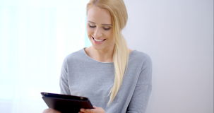 Happy Young Woman Busy with Tablet Computer stock video