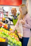 Happy young woman buying fruits Stock Photo