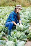 Happy young woman with cabbage Stock Photography