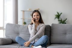 Free Happy Young Woman Caller Talking On The Phone At Home Stock Images - 138231964