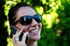 Happy young woman calling on mobile phone Stock Photos