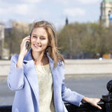 Happy young woman calling by phone Stock Photo
